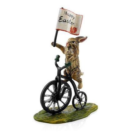 Hase auf Hochrad mit Fahne