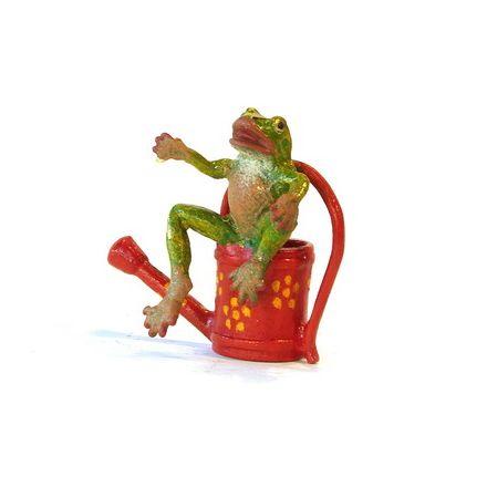 Frosch sitz. auf Gießkanne