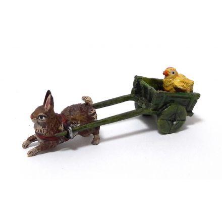 Hase zieht Wagen mit Küken